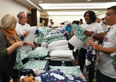 2019 ELFA volunteers Giving back donated supplies
